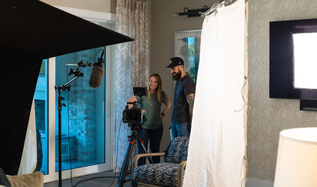 Kevin Echemendia of Two Stories Media and Alyssa Gay work together on a commercial videography production for Trade Mark Interiors.