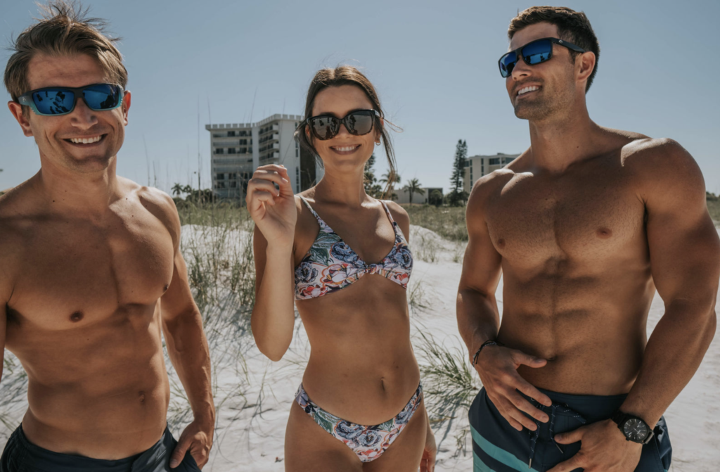 2 male and 1 female model; modeling swim suit clothing for a local swim wear boutique
